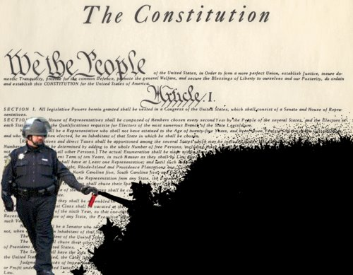 Pepper-spraying-cop-john-pike-spraying-the-constitution