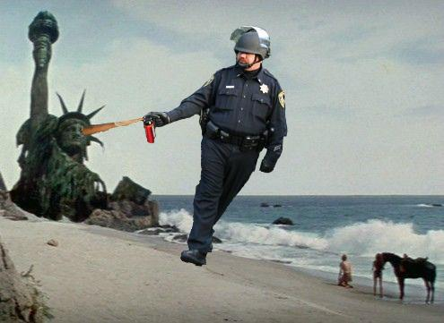 Pepper-spraying-cop-john-pike-spraying-statue-of-liberty-in-planet-of-the-apes